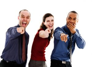 Business Team Laughing at Another Coworker