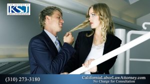 Image of man grabbing a womans hair in an office