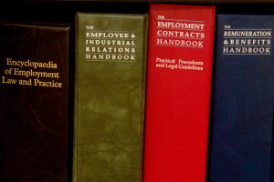 Photo of an Employee Handbook and Forms